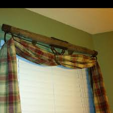 old farm equipment for a curtain rod