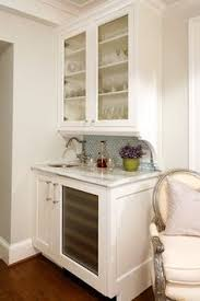 brashwell white bar cabinet on wall with frosted gl door cabinet and grey ceramic backsplash also white sned wood vanity and faucet an image part of