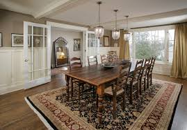 rustic dining room design. farm table dining room traditional with beige curtain black rug rustic design