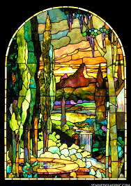 this tiffany style stained glass window panel features a beautiful past scene with trees a fountain and even a waterfall