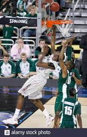 Michigan State Spartans' Idong Ibok (R-top) tries to block a shot from  Connecticut Huskies' Hasheem