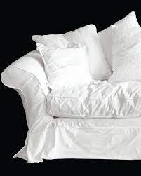 white slipcovered sofas are back in
