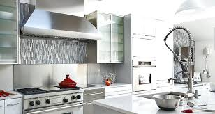 stainless steel kitchen backsplash ideas for white cabinets black countertop