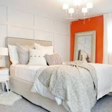 White Bedroom With Orange Accent Wall