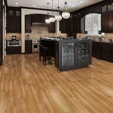 dark kitchen island with kitchen bar stools and pendant lighting plus vinyl plank flooring