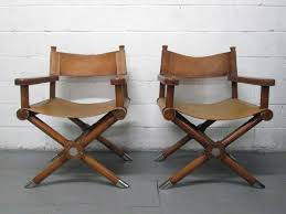 pair ralph lauren leather directors chairs walnut frames with saddle leather seats has nickel