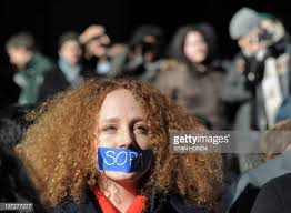 Nadine Wolf wears tape over her mouth as she joins a protest by the... News  Photo - Getty Images