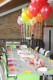 Use candy bags with color coordinating candy as balloon weights for table  centerpiece. Allow kids to take the balloon and candy bag (doggie bag) home.