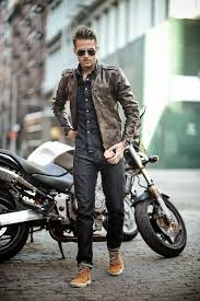 black jeans a chambray shirt a brown leather jacket and yellow sneakers