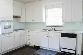 white painted cabinetsPainting oak cabinets white An amazing transformation  Lovely Etc