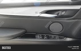 car door handle inside the luxury modern car with black leather and switch on control modern