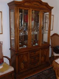 terrific stanley chinese cabinet and hutch with three glass door design high woden head and three lockers with carving design under