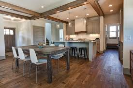 wood is an exceptionally elegant choice for a kitchen floor but it does need a bit