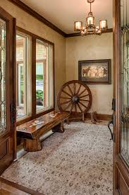 rustic style entry hall idea glossy top wood entry bench decorative wheel in rustic look area