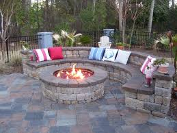 Exterior:Fire Pit Near Stone Bench Beyond Black Garden Fences Of Small  Winter Patio Fire