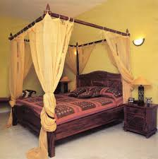 smart use of canopy bed drapes. Canopy Bed With Yellow Curtain Smart Use Of Drapes U