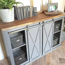 close up of the gray sliding barn door console table for see with hardware cabinets