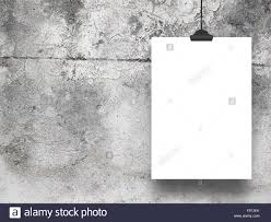 single paper sheet frame hanged with clothes pin on old concrete wall background