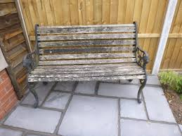 rustic wooden garden bench wrought iron arms legs