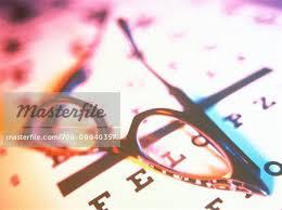 Close Up Of Eyeglasses On Eye Chart Stock Photo