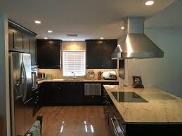 open concept kitchen features dark wood cabinets