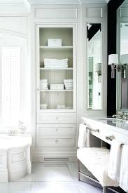 bathroom storage wainscoted tub with glass door inset linen cabinet white bathroom floor cabinet glass