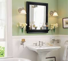 white and sage green wall color with black wooden framed mirror for tranquil bathroom decor ideas
