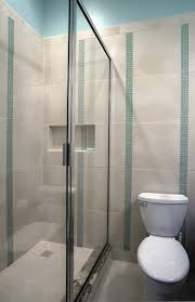 bathroom ideas corner shower design: curved shape glass shower  interior bathroom modern glass shower stall with stailess steel frame for small bathroom combined with grey ceramic wall panel using green green glass mosaic line accent tiny bathrooms with shower x