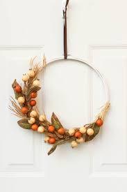 A cheap fall decor idea! Use an embroidery hoop to make a beautiful fall  wreath