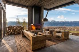 mountain view outdoor room with modern fireplace
