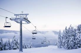 to empty chair ski lift on bright winter day free stock photo