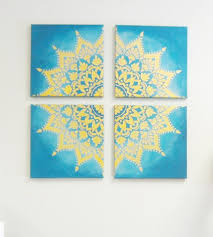 a man tapes together 4 canvases from michaels look at his amazing idea for your wall canvas artwork mandala and stenciling on diy wall art michaels with a man tapes together 4 canvases from michaels look at his amazing