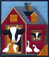 round barn quilt pattern | cow and her calf peek from the ... & round barn quilt pattern | cow and her calf peek from the sheltering barn  eager to Adamdwight.com