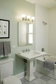 baroque kohler pedestal sink in bathroom traditional with toilet next to small toilet space alongside tile tub