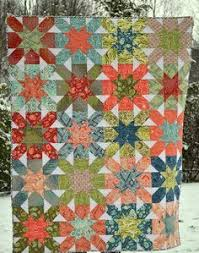 We have this hand-stitched quilt (titled Winter Wonderland) in ... & This is a beautiful and simple patchwork quilt with blocks sewn into prints  in which they Adamdwight.com
