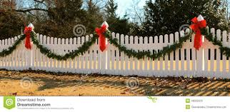 Christmas Decorations For Your Fence : Wreath on fence decorated for  christmas stock photo