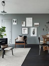 wall color for black furniture. black floors grey walls and lots of art pieces via cocolapinedesigncom wall color for furniture