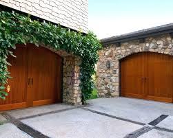 arched garage doors exle of a clic two car garage design in arched garage door lintel