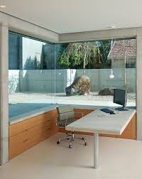 outside home office. corner window of the home office offers a glimpse into rock garden outside design