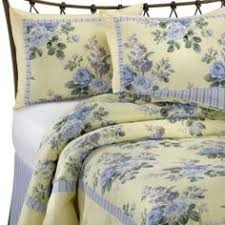 This Laura Ashley quilt set sports a yellow and blue floral print ... & Bring a touch of charm to your bedroom with the lovely Laura Ashley Caroline  Comforter Set Adamdwight.com