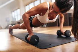 gym woman doing push up exercise with dumbbell strong female doing gym workout