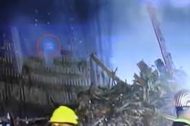 Eerie 9/11 footage captures 'ghost' rising from the wreckage of the ...