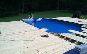 Above ground pool with deck attached to house Decking Above Ground Pool Deck Building Process Backyard Leisure Building Deck For An Above Ground Pool What You Need To Know