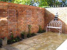 Small Picture The kitchen garden is accented by a new stone and brick wall and a