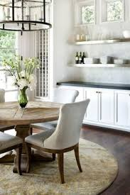 contemporary dining room by jauregui architecture interiors construction round table rug and upholstered chairs