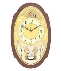 decorative alarm clock and rhythm small world clock and howard miller wall clocks