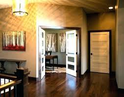 gray walls black trim black trim white doors black baseboards and door frames dark baseboard trim