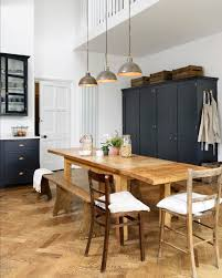 a bank of four devol pantry cupboards sat against the back wall of this beautiful room they are big deep cupboards housing a full height fridge and