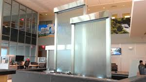 on water wall art youtube with glass water walls custom waterfall feature in lobby youtube