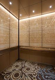 levele 105 elevator interior with upper panels in vivistone honey onyx
